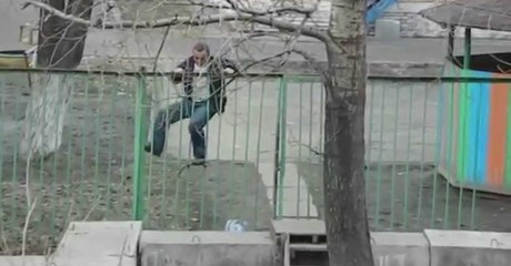 Drunk guy passing over the fence
